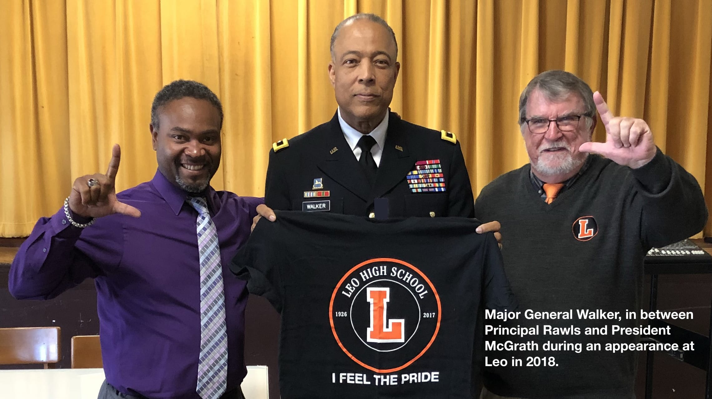 Major General Walker, in between Principal Rawls and President McGrath during an appearance at Leo in 2018